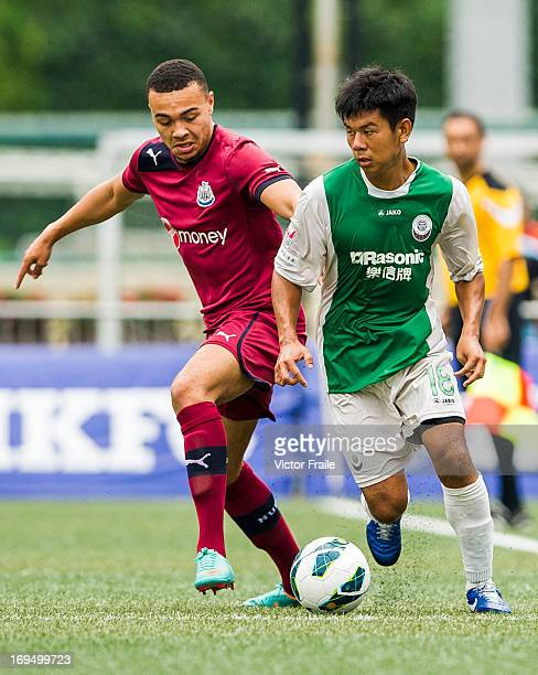 Remie Streete of Newcastle United and Sham Kwok Keung of Citizen fight for the ball on day three of the Hong Kong International Soccer Sevens at Hong...