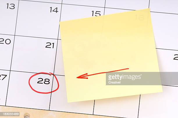 Reminder for important date, yellow sticky note with red arrow