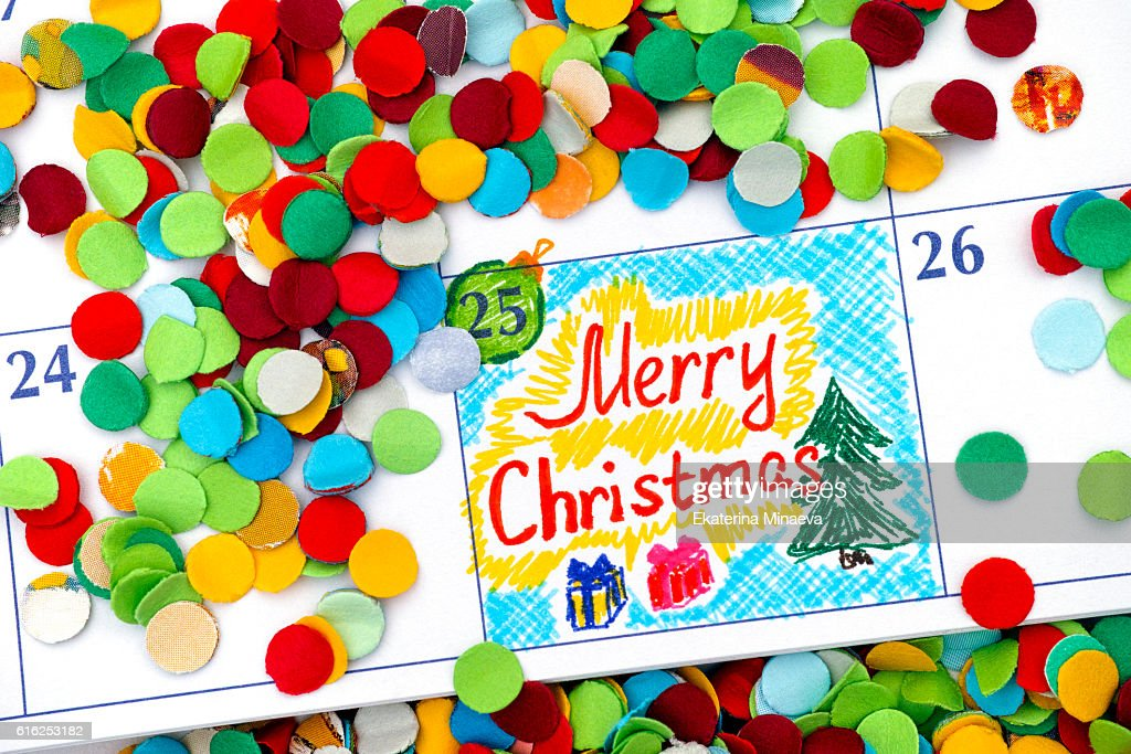 Reminder Merry Christmas in calendar with confetti : Stock Photo