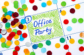 Reminder Office Party in calendar with confetti. Close-up.