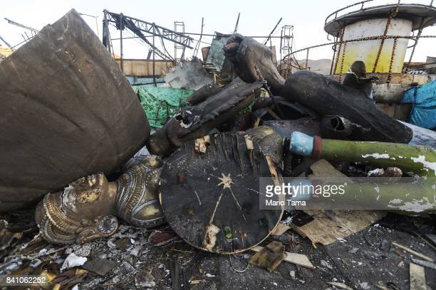 Remnants of Carnival float sculptures rest amidst the rubble of the Carnival floats warehouse for the Renascer de Jacarepagua samba school on August...