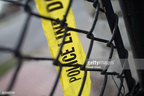 Remnants of crime scene tape remain on a fence in Foster Park following a shooting on April 19 2016 in Chicago Illinois Four people were wounded and...