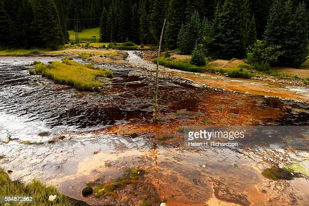 Remnants of the Gold King Mine spill are still evident in Cement Creek far below the mine on August 17 2016 near Silverton Colorado A mining and...