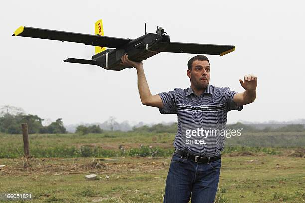 Remo Peduzzi managing director of Research Drones Limited Company of Switzerland launches an unmanned aerial vehicle for flight at the Kaziranga...