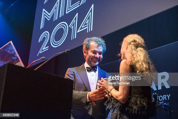 Remo Ruffini and Franca Sozzani appear on stage during the amfAR Milano 2014 Gala Dinner and Auction as part of Milan Fashion Week Womenswear...