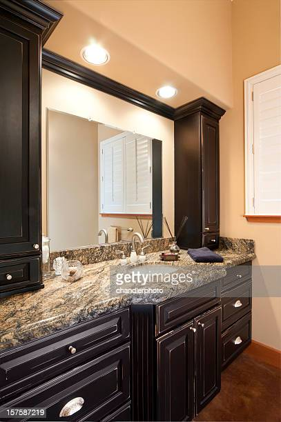Remodeled bathroom with dark cabinets and granite countertop
