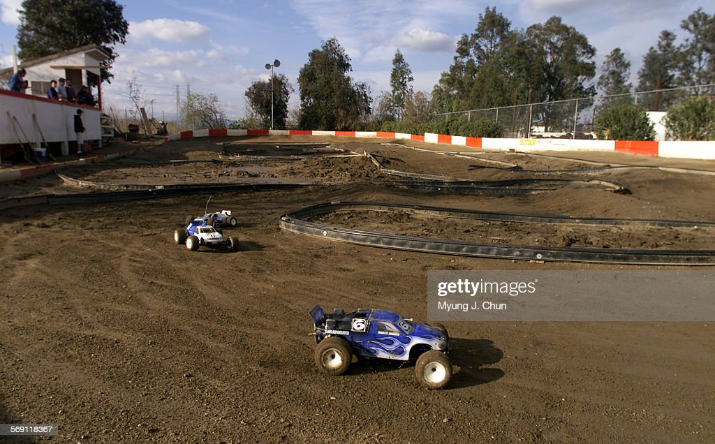 Remote controlled cars get in practice runs at the Hot Rod Hobbies race track in Saugus Top drivers from across the nation will compete in the 16th...