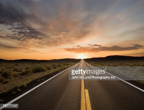 Remote road at dusk : Stock Photo