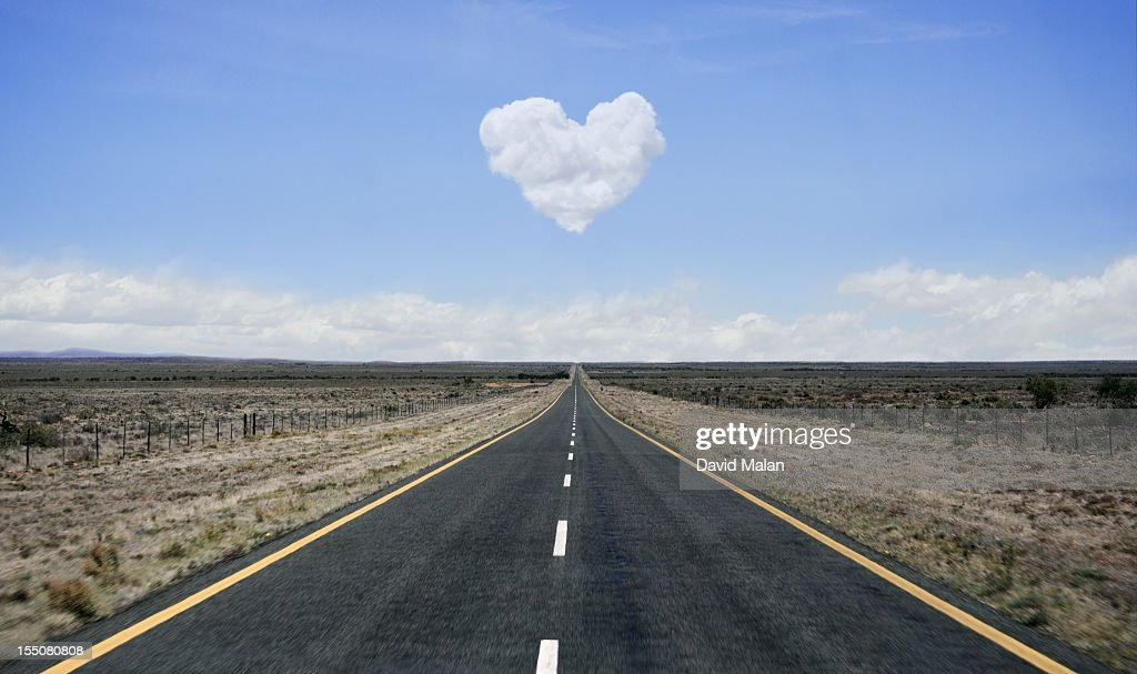 Remote road with heart shaped cloud over it. : Stock Photo
