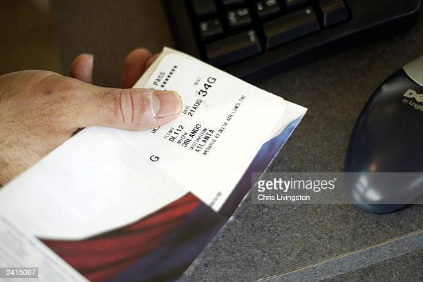 Remote skycap Ricky Cohen holds an issued boarding pass August 21 2003 at the Rosen Centre Hotel in Orlando Florida The pilot program is the first in...
