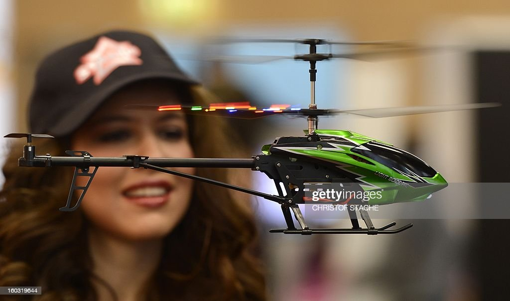 A remote-controlled helicopter flys during the press preview of the international toy fair in Nuremberg, southern Germany, on January 29, 2013. Around 2.700 exhibitors show more than 1 million products at the international toy fair which opens its doors from January 29 to February 4, 2013.
