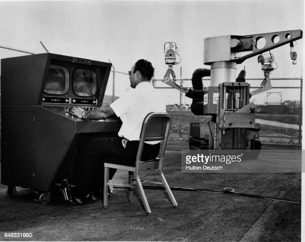 Remotely Controlled MOBOT* system manufactured by Hughes Aircraft Company Fullerton Calif for the Atomic Energy Division of the Phillips Petroleum...