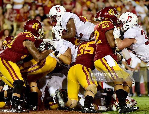 Remound Wright of the Stanford Cardinal jumps over the pile to score a touchdown to take a 3428 lead over USC Trojans during the third quarter at Los...