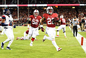 Remound Wright of the Stanford Cardinal scores a touchdown on a sixteen yard pass play against the Arizona Wildcats in the second quarter of an NCAA...