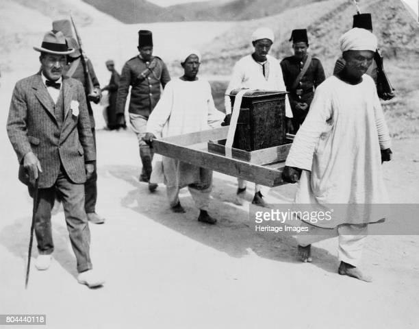 Removal of the gilt shrine from the Tomb of Tutankhamun Valley of the Kings Egypt 19221923 Archaeologist Howard Carter walks alongside the bearers...