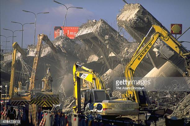 Removal work of the collapsed Hanshin Expressway elevated highway begins on January 24 1995 in Kobe Hyogo Japan Magnitude 73 strong earthquake jolted...