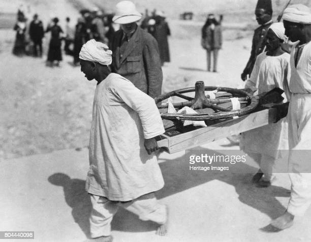 Removing a chariot wheel from the Tomb of Tutankhamun Valley of the Kings Egypt 1922 The discovery of Tutankhamun's tomb in the Valley of the Kings...