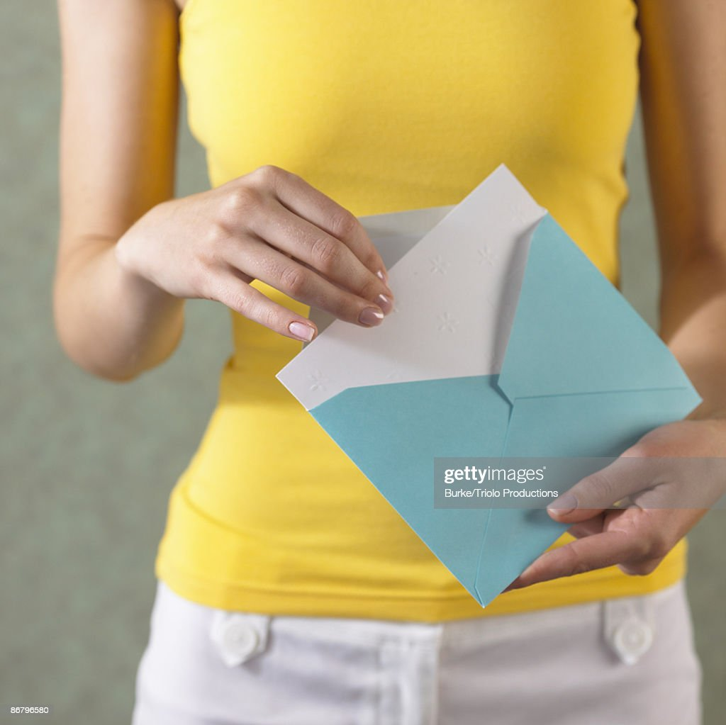 Removing card from envelope : Stock Photo