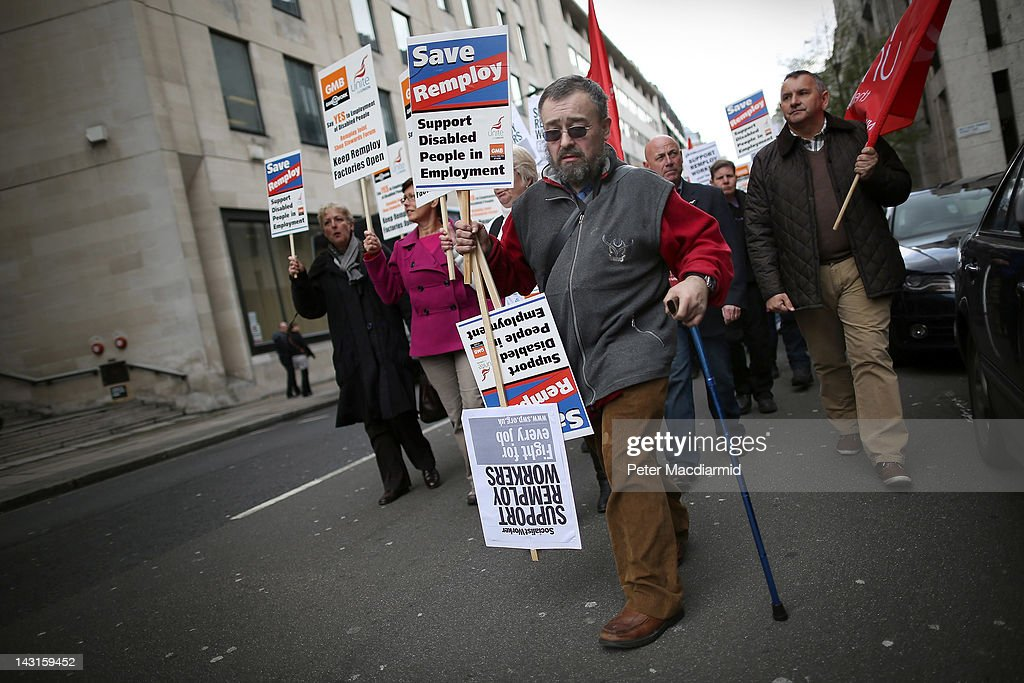 Remploy factory workers march to Parliament on April 20, 2012 in London, England. Disabled workers are calling for the government to think again after it announced the closure of 36 out of 54 Remploy factories. Unions say that up to 1700 workers could become unemployed.