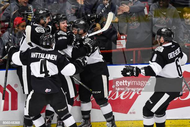 Remy Anglehart of the BlainvilleBoisbriand Armada celebrates his first period goal with teammates against the RouynNoranda Huskies during the QMJHL...