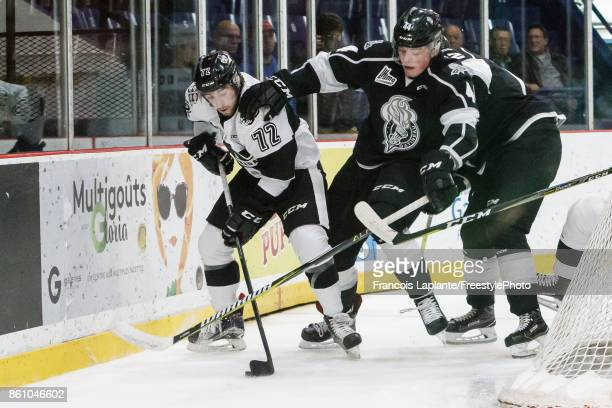 Remy Anglehart of the BlainvilleBoisbriand Armada controls the puck against Gabriel Bilodeau of the Gatineau Olympiques on October 13 2017 at Robert...