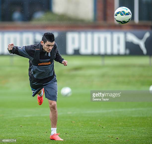 Remy Cabella heads the ball during a Newcastle United First Team Training Session at the Newcastle United Training Centre on September 18 in...