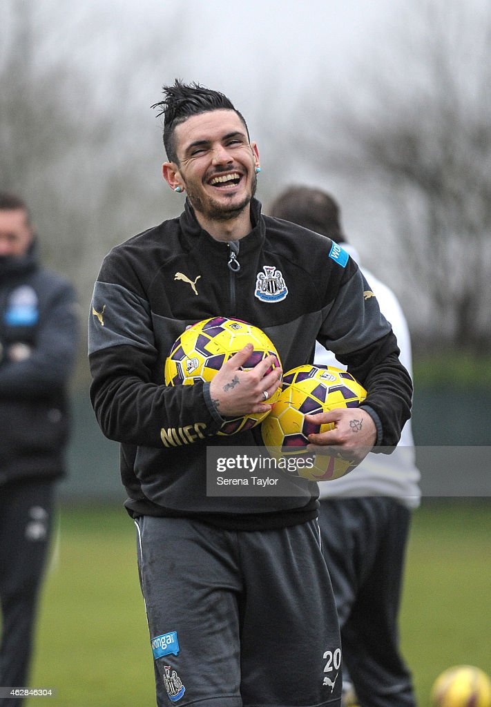 Remy Cabella laughs whilst holding 2 balls in his arms during a training session at The Newcastle United Training Centre on February 06, 2015, in Newcastle upon Tyne, England.