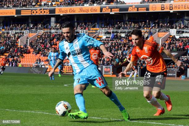 Remy Cabella of Marseille and Vincent Le Goff of Lorient during the French Ligue 1 match between Lorient and Marseille at Stade du Moustoir on March...