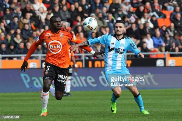Remy Cabella of Marseille and Zargo Toure of Lorient during the French Ligue 1 match between Lorient and Marseille at Stade du Moustoir on March 5...