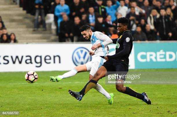 Remy Cabella of Marseille score the third goal and Jemerson of Monaco during the French Cup match between Marseille and Monaco at Stade Velodrome on...