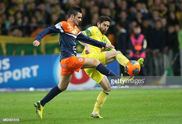 Remy Cabella of Montpellier and Olivier Veigneau of Nantes in action during the french Ligue 1 match between FC Nantes and Montpellier Herault SC at...