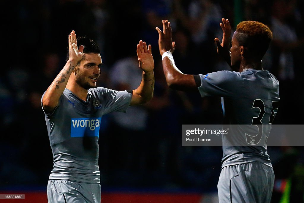 Remy Cabella (L) of Newcastle celebrates his goal during the Pre Season Friendly match between Huddersfield Town and Newcastle United at the John Smith's Stadium on August 5, 2014 in Huddersfield, England.