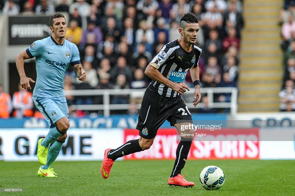 Remy Cabella of Newcastle runs with the ball during the Barclays Premier League match between Newcastle United and Manchester City at St.James' Park on August 17, 2014, in Newcastle upon Tyne, England.