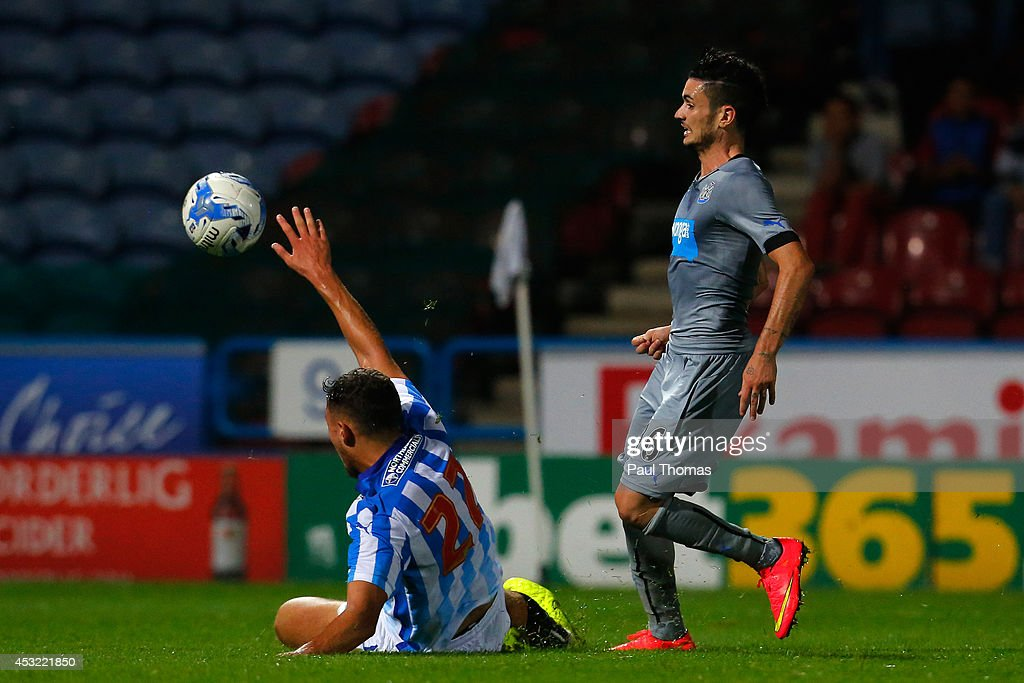 Remy Cabella of Newcastle scores his sides second goal during the Pre Season Friendly match between Huddersfield Town and Newcastle United at the John Smith's Stadium on August 5, 2014 in Huddersfield, England.