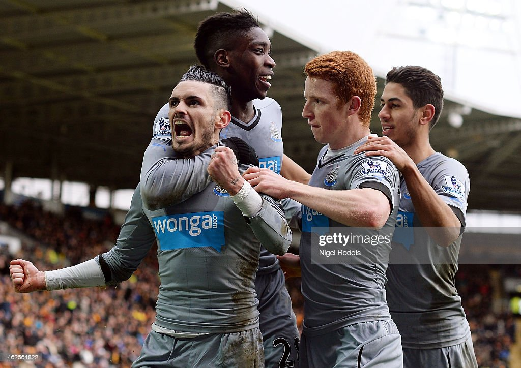 Remy Cabella of Newcastle United celebrates scoring the opening goal with team mates during the Barclays Premier League match between Hull City and Newcastle United at KC Stadium on January 31, 2015 in Hull, England.