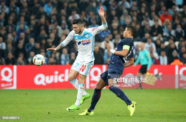 Remy Cabella of OM and Thiago Silva of PSG in action during the French Ligue 1 match between Olympique de Marseille and Paris Saint Germain at Stade...