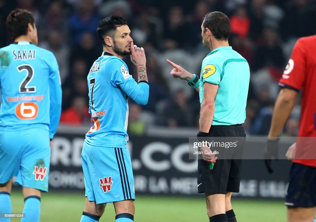Remy Cabella of OM is warned by the referee Mikael Lesage during the French Ligue 1 match between Lille OSC (LOSC) and Olympique de Marseille (OM) at Stade Pierre-Mauroy on March 17, 2017 in Lille, France.