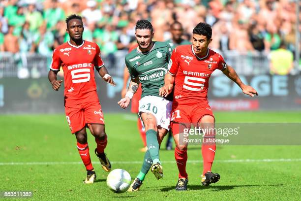 Remy Cabella of Saint Etienne and Benjamin Andre of Rennes during the Ligue 1 match between AS Saint Etienne and Stade Rennais at Stade Geoffroy...