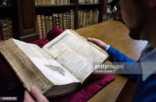 Remy Cordonnier librarian in the northern town of SaintOmer near Calais carefully shows on November 25 2014 in SaintOmer an example of a valuable...