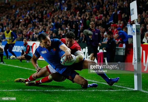 Remy Grosso of France holds off Ciaran Hearn of Canada as he scores their fifth try during the 2015 Rugby World Cup Pool D match between France and...