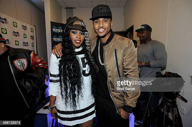 Remy Ma and Trey Songz pose backstage at Power 1051's Powerhouse 2014 at Barclays Center of Brooklyn on October 30 2014 in New York City