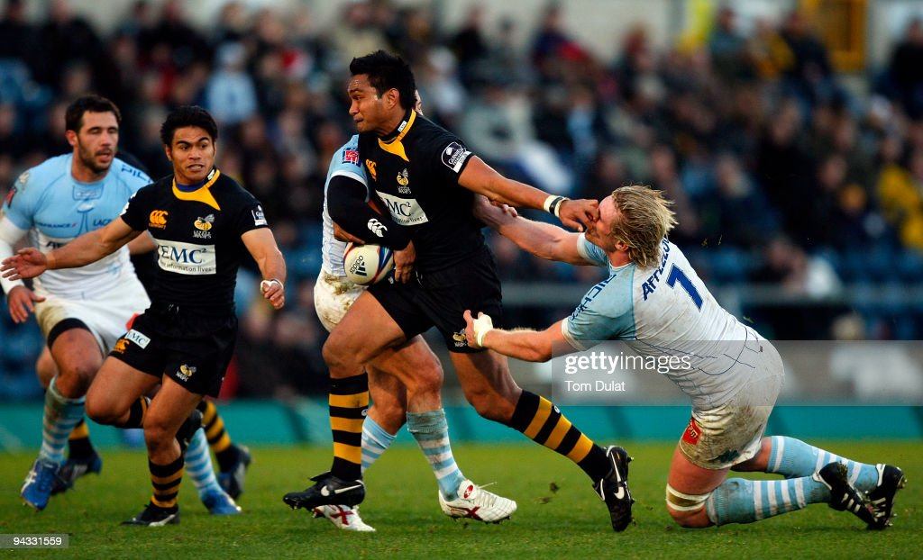 Remy Martin of Bayonne fails to stop running with the ball Steve Kefu of London Wasps during the Amlin Challenge Cup match between London Wasps and...