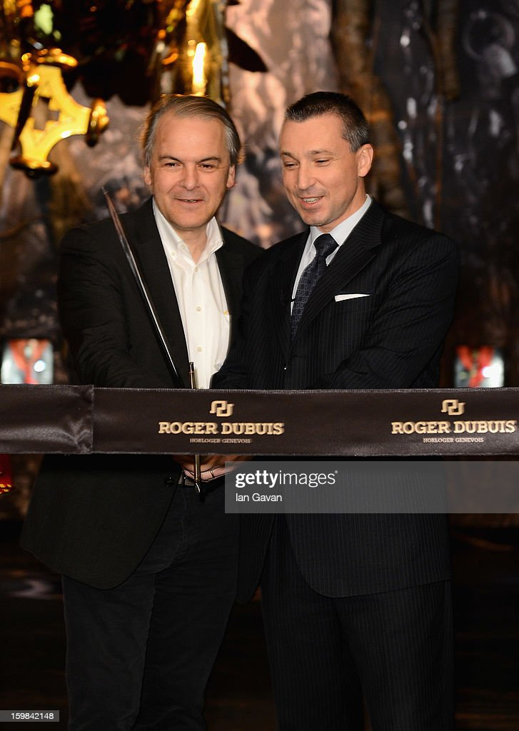 Remy Pagani (L), Mayor of Geneva opens the Roger Dubuis booth with Jean-Marc Pontroue, CEO of Roger Dubuis during the 23rd Salon International de la Haute Horlogerie at the Geneva Palexpo on January 21, 2013 in Geneva, Switzerland.
