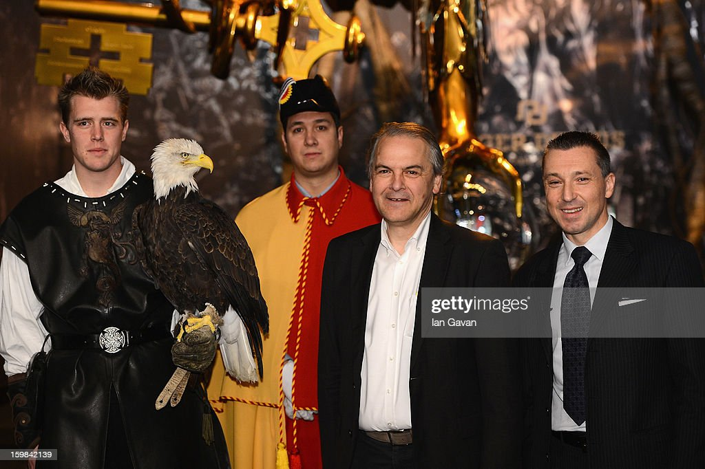 Remy Pagani (2ndR), Mayor of Geneva poses with Jean-Marc Pontroue (R), CEO of Roger Dubuis and an eagle at the opening ceremony of the Roger Dubuis booth during the 23rd Salon International de la Haute Horlogerie at the Geneva Palexpo on January 21, 2013 in Geneva, Switzerland.