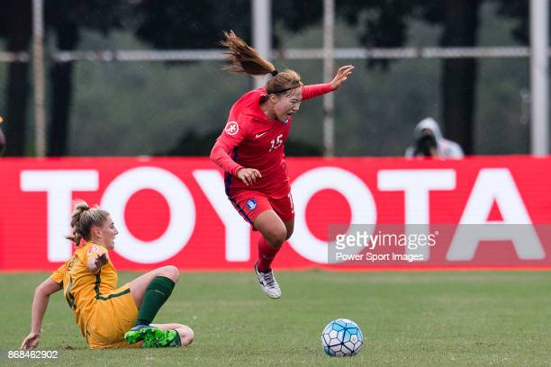 Remy Siemsen of Australia trips up with Sim Seohui of South Korea during their AFC U19 Women's Championship 2017 Group Stage B match between South...