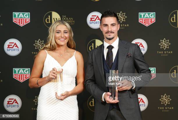 Remy Siemsen of Sydney FC and Jamie Maclaren of Brisbane Roar pose with the NAB Young Footballer of the Year awards during the FFA Dolan Warren...