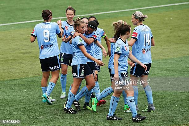 Remy Siemsen of Sydney FC celebrates with team mates after scoring a goal during the round four WLeague match between Sydney FC and Adelaide United...