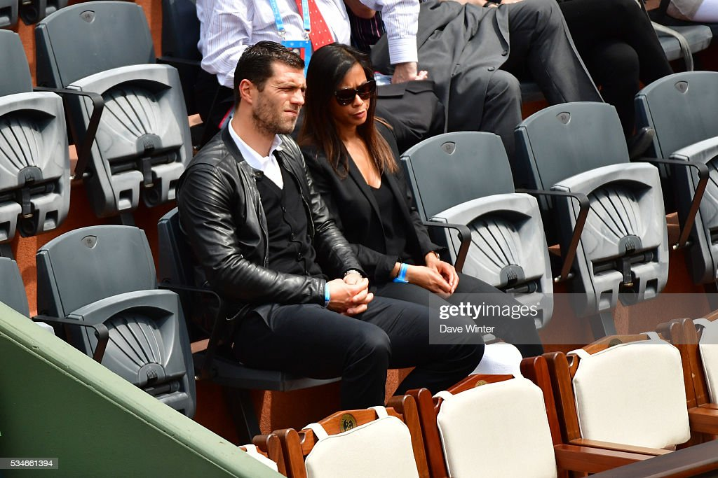 Remy Vercoutre and his wife during the Women's Singles third round on day six of the French Open 2016 at Roland Garros on May 27, 2016 in Paris, France.