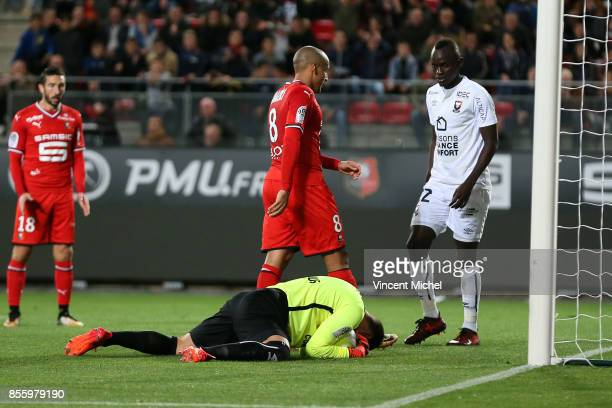 Remy Vercoutre of Caen and Wahbi Khazri of Rennes during the Ligue 1 match between Stade Rennais and SM Caen at Roazhon Park on September 30 2017 in...