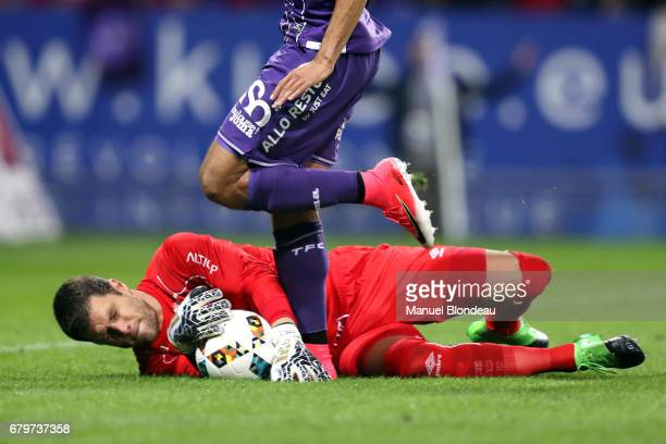 Remy Vercoutre of Caen makes a save under pressure from Martin Braithwaite of Toulouse during the Ligue 1 match between Toulouse FC and SM Caen at...
